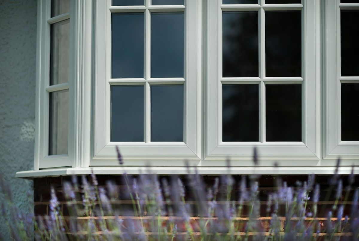 PVCu bay window with duplex georgian bar, photographed with lavender in front of it.