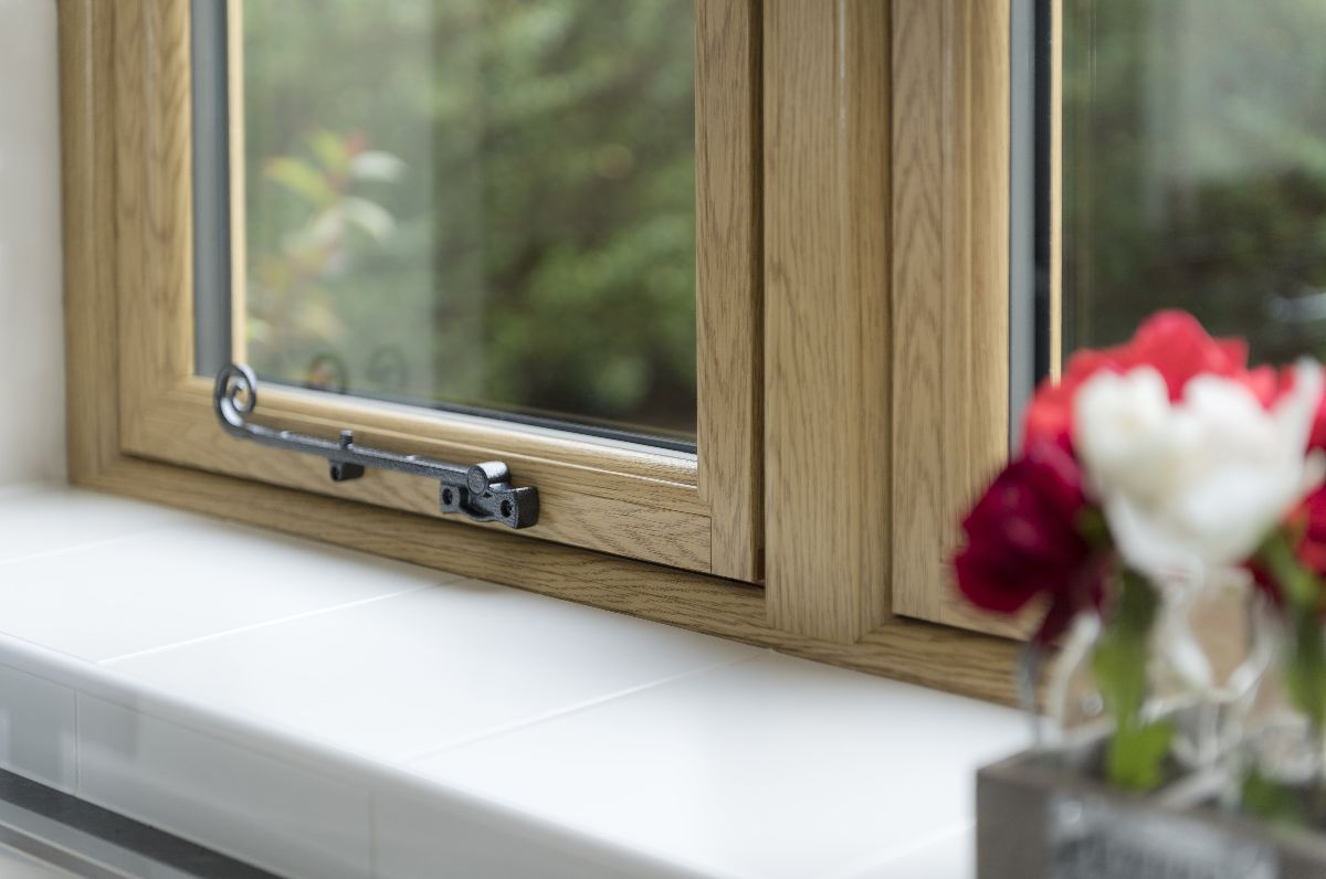 Cottage window shown from the inside, with a window stay. Modern PVCu window, recreating a timber cottage look.